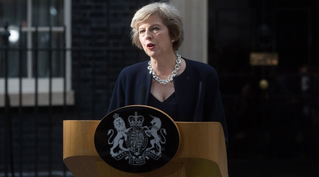Theresa May, U.K. prime minister, delivers a speech outside 10 Downing Street in London, U.K. on Wednesday, July 13, 2016. May became the U.K.'s second female prime minister and has promised to take Britain out of the European Union. Photographer: Simon Dawson/Bloomberg